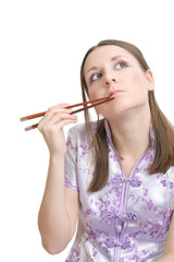 Woman with chopsticks for sushi