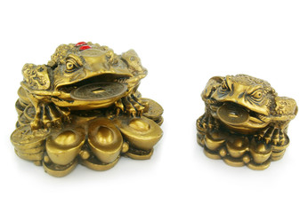 Statuette of two frogs with chinks isolated
