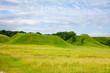 green hill blue cloudy sky