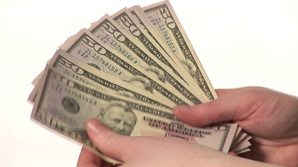 Woman hands holding dollars