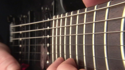 Closeup of fingers playing a classical guitar