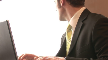 Young businessman using a laptop in a train footage