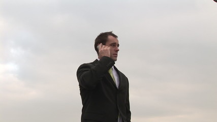 Businessman talking on a mobile phone outdoors