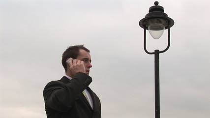 Footage of an attractive businessman on phone outdoors