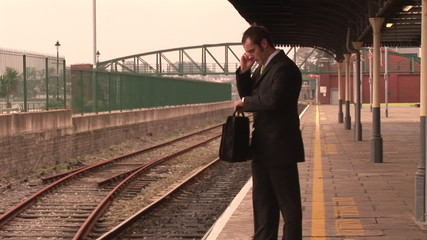 Busy businessman on phone in a train station footage