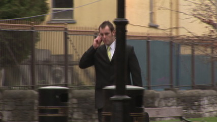 Footage of a Businessman Talking on a Mobile Phone in Park