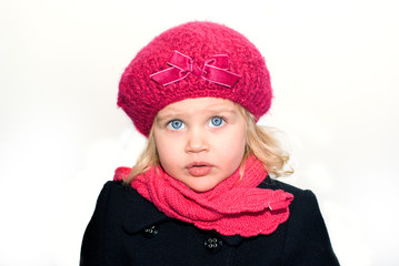 beautiful girl in a pink beret with a scarf