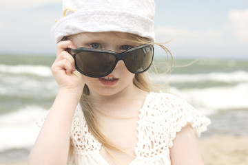 Little girl and big sunglasses II
