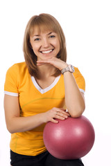 Fitness girl with a red ball