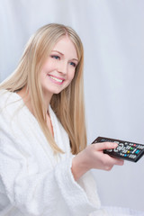 Blond hair girl holding remote controller