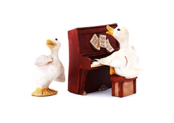 Singing and piano playing duck duo.