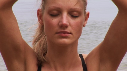 Beautiful and relaxed woman meditating