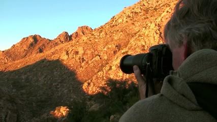 Photographer in desert landscape V2 - HD