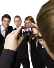 Man taking photos of his friends