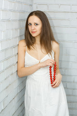 pretty girl with red beads