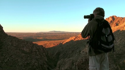 Photographer in desert landscape - HD