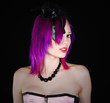 Attractive Emo Girl in Pink Corset Looking at Camera