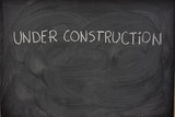 under construction phrase on a blackboard poster