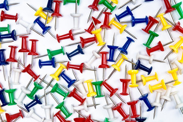 Colorful pins over the white background