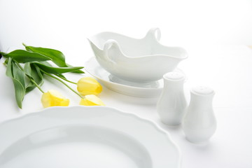 White Pottery with yellow flower on white background