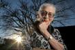 Portrait of elderly woman outdoors, thinking
