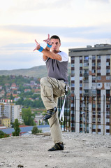 young man jumping in air outdoor at night ready to party