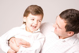 happy father and son on white background