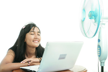 woman relaxing on table with electric fan