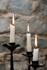 Three candles in candlestick