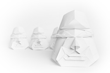 4 origami faces on a white background