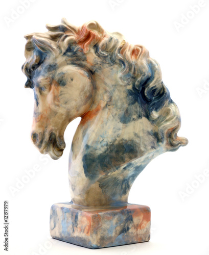Elaborate horse head statue with marble surface.