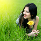 Fototapety beautiful young woman relaxing in the grass