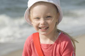 Smiling cheerful girl on the beach II