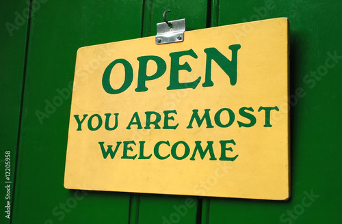 poster of polite old welcome sign hanging in a doorway
