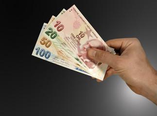 Turkish lira in hand