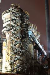 Old rusty industrial building in night