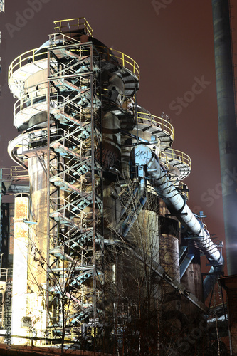 Old rusty industrial building in night