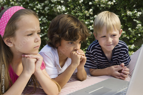 Shocked Little Kids Looking at a Laptop