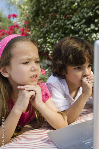 Little Kids Looking at a Laptop