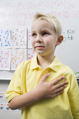 Schoolboy with His Hand over His Heart