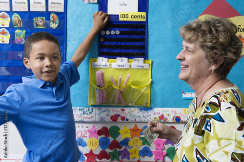 Elementary Student Learning to Count Money