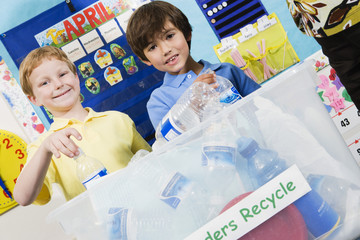 Elementary Students with Recycling Container