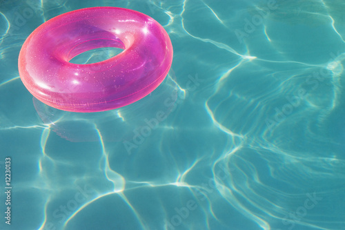 Pink Float Tube Floating in Swimming Pool