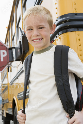 School Boy by School Bus