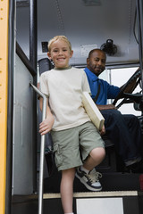 Little Boy Getting off of Schoolbus
