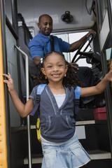 Little Girl Getting off of Schoolbus