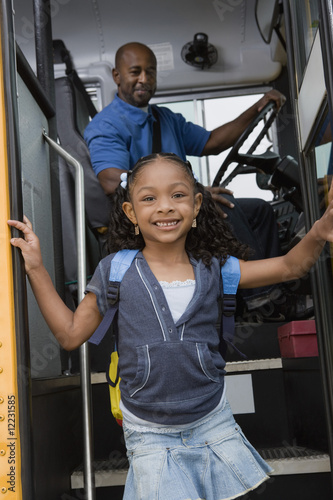 Little Girl Getting off of Schoolbus