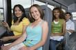 Teenagers Riding School Bus