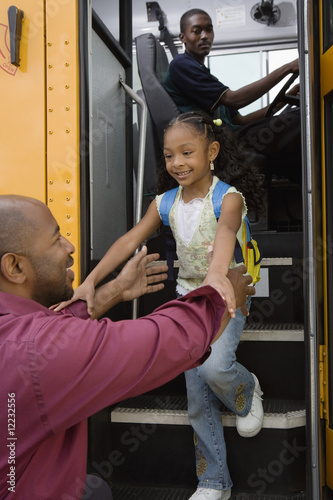 Father Picking Daughter Up at Bus Stop