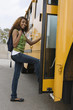 Teenage Girl Getting on School Bus